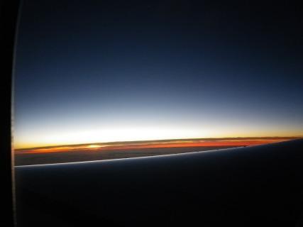 Plane window photo sunrise 2